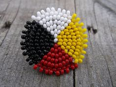 medicine wheel pin, native american beadwork by deancouchie on Etsy Native Beading Patterns, Beadwork Designs, Seed Bead Patterns, Beaded Jewelry Patterns, Beaded Earrings Native, Native Beadwork, Native American Beadwork, Seed Bead Earrings, Native American Patterns