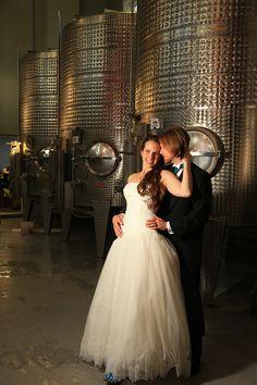beaux vineyard bride and groom in wine cellar