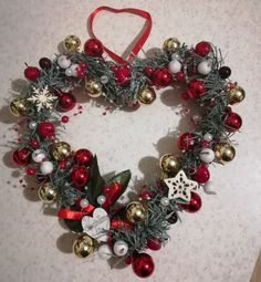 Red & gold Christmas heart-shaped wreath.