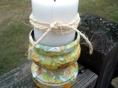 Mod Podge Map Pieces onto a candle holder.