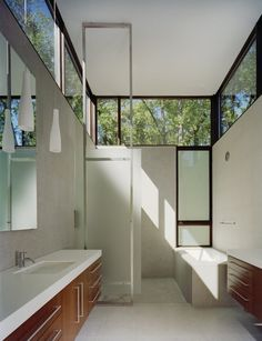 Incredible bathroom- love the height and how the windows at the top create natural brightness