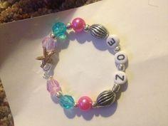 Under the sea birthday party bracelets .