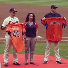 Freddie Freeman and Craig Kimbrel receive their All Star jerseys.