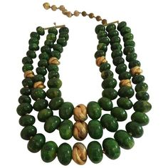 Preowned 1950s Castlecliff Faux Jade 3 Strand Bakelite And Goldtone... ($695) ❤ liked on Polyvore featuring jewelry, necklaces, green, beaded necklaces, jade bead necklace, green necklace, green jade necklace and long strand necklace