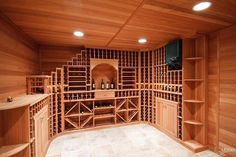 Contemporary Wine Cellar with travertine tile floors, Built-in bookshelf