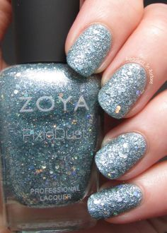 Zoya Vega: A blue opal sparkle, textured PixieDust with mega hex holographic glitter. Showing 2 coats with no top coat.