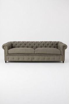 I think I've decided I want a tufted couch... but I can't decide if I want a plain grey or brown or a colored one, like green or blue...