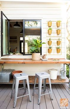 A potting bench is practically an essential feature of an outdoor space. The space can double as a bar for outdoor entertaining, too!
