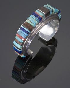 Cuff | Charles Loloma.  Sterling silver with Kingman turquoise, ironwood, Mediterranean coral and lapis | ca. 1960s