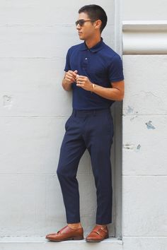 Team a navy polo with navy blue suit pants for drinks after work. A pair of brown leather double monks will seamlessly integrate within a variety of outfits. Shop this look on Lookastic: https://lookastic.com/men/looks/navy-polo-navy-dress-pants-brown-leather-double-monks/20584 — Navy Polo — Navy Dress Pants — Brown Leather Double Monks