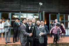 October wedding. Groom and friends taking a selfie, outside New Guesten Hall at Avoncroft Museum of Historic Buildings (avoncroft.org.uk). Jay Emme Photography.