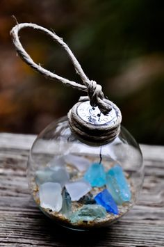 Beach Glass Ornament Also do this with sharks teeth and other bits and pieces from traveling