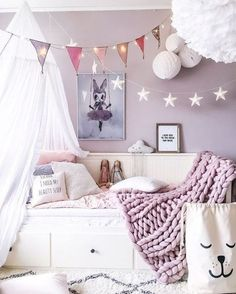 lavender, mauve, pink and grey girls room with chunky knit blanket and modern whimsical details and bed canopy #kidsroomideas #mauvedecor #lavenderdecor