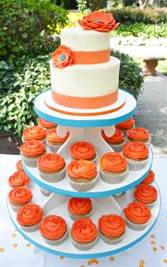 Orange and Teal Wedding Cake - @Monica Gutierrez Something like this would be perfect for your baby shower when you have a girl!