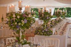 Beautiful reception with flowers & candles.  http://www.whitesatinweddingshow.com/hideaways-en-france.html