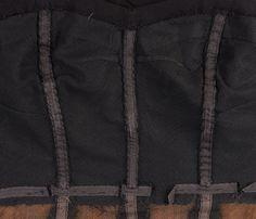 interior of Black corset with rouched cummerbund dress of Dior H.C.