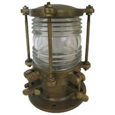 Solid bronze piling dock light with 360 degree Fresnel Lens. The glass lens is stepped to provide a wide array of light with a low amount of power. The body is made of solid bronze bringing the light to a 20 pound weight. Old Lanterns, Vintage Lanterns, Vintage Wall Lights, Modern Wall Lights, Dock Lighting, Strip Lighting, Coleman Lantern, Led Wall Lamp, Lantern Candle Holders