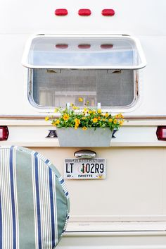 For our three-day Airstream makeover challenge, we took this 1973 Argosy Airstream from drab to dreamy. Travel Trailer Decor, Window Boxes, Airstream, Transportation, Journey, Flower Boxes, Planters, Airstream Trailers