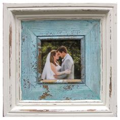 Featuring molding details and a distressed finish, this picture frame is the perfect addition to your living room or entryway. Pro...