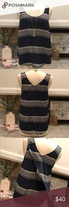 ⛱Lucky Brand Silk Top⛱ NWT Super cute Lucky Brand silk top. In Navy with thin white stripes. Has a fabric overlay in the back which gives it a unique look. Perfect for this summer. No Trades. Accepting offers. 😊 Lucky Brand Tops Tank Tops