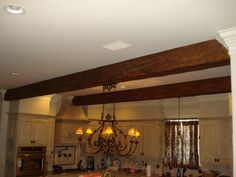 Faux timber beams can look like real support beams from older construction.