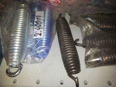 Manufactured tension springs covered with plastic to protect the products.