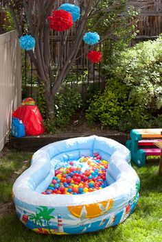 Make a ball pit outside with a big blowup pool