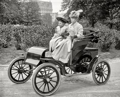 "Washington, D.C., circa 1905. ""Women in Pope-Waverley electric runabout."" Seems like the electric car is coming back, Should have  saved a lot of gas and never stopped making them."