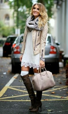 leather moto jacket, infinity scarf, white dress with knee high leather boots and large bag.