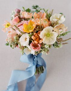 This Four Seasons Resort Lanai Wedding Is Your Ticket To Paradise: Bright colors fill this bride's bouquet and she added her something blue with the addition of a blue ribbon!
