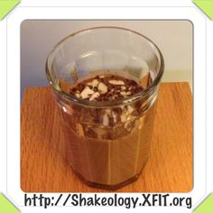 #Satisfy your #sweettooth with this #Healthy Dark Chocolate Almond Bar #Shakeology #recipe. Seriously, as tasty as a #candybar without the #guilt.   *8oz. of your #fav milk (coconut for me) *1scoop Chocolate Shakeology (vegan or whey) *1cup ice *Blend and pour *Garnish with 85% dark chocolate shavings and sliced almonds. http://Shakeology.XFIT.org