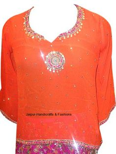 Shop online this amazingly smart and sensuous kurti to dress uniquely for parties and outings. This ethnic top comes with a beautiful pink and green embroidery on the base.