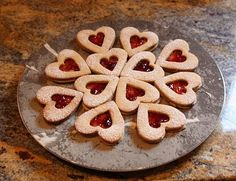 German Christmas Cookies Linzer hearts (or Linzer Herzen in German) are the cookie variation from the Linzer Cake. Easy to make German Christmas Cookie. German Christmas Decorations, German Christmas Cookies, German Cookies, Christmas Desserts, Christmas Treats, Christmas Baking, German Cake, Christmas Place, Christmas Recipes