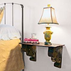 Flank the Bed How to do it: Build a wall-mount bedside table with wood corbels topped by a slate roof shingle. Wall Mounted Bedside Table, Wall Mounted Tv, Bedside Tables, Bedside Lamp, Shelf Nightstand, Home Upgrades, Home Improvement Projects, Home Projects, Wood Closet Shelves