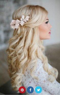 Half up half down with flowers #weddinghairstyleswithflowers