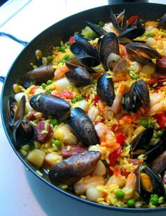 Paella with chicken and shrimp, bay scallops, and mussels