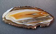 Agate is a variety of chalcedony with multi-colored curved or angular banding. Fire agate shows iridescent phenomena on a brown background;