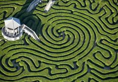 Longleat Hedge Maze @ Wiltshire, England  England is beautiful to behold at ground level and from the window seat. If you're flying low enough over Wiltshire, west of London, perhaps you'll catch a glimpse of several curiously shaped mazes at Longleat House. Alexander Thynn, the Seventh Marquess of Bath, is responsible for creating the hedge maze (pictured), the love labyrinth, the sun maze, the lunar labyrinth and King Arthur's maze.