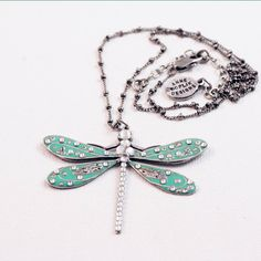 Enjoy the sea blue/greens and sparkly Swarovski crystals on the hand enameled dragonfly. Light weight, easy to wear from day to summer evening. The Dragonfly symbolizes transformation, renewal, self r Dragonfly Necklace, Pendant Necklace, Green Topaz, Blue Green, Dior, Best Jewelry Stores, Girls Necklaces, Chanel, Artisan Jewelry