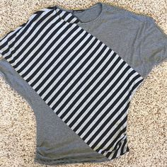 Ella Moss top Dolman style short sleeve top with ruched sides. Black and heather gray stripes. Fits great and excellent condition. Ella Moss Tops Blouses