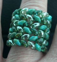 A wide ring made with Super Duo beads