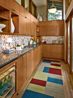 i bet you can find a cabinet style like this in kitchens that look like they need to be totally remodeled....but....new counters, handles, and backsplash could totally update it while still maintaining the midmod style