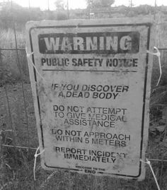A sign that explains what to do if you find a dead body in a specific area. Actually, you should follow those steps anywhere.