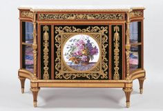 Adam Weisweiler (1744-1820)  Cabinet  c.1785-95 Oak veneered with ebony and tulipwood, bronze chased and gilt mounts, soft-paste porcelain plaque, brocatello marble shelve