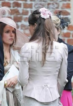 Older pic of Catherine at a wedding/I believe that is one of George's Godparents with her.