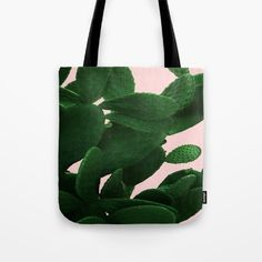 "Cactus On Pink Tote Bag by ARTbyJWP from Society6 #bags #totebag #handbag #fabricbag #cactus  ---   Our quality crafted Tote Bags are hand sewn in America using durable, yet lightweight, poly poplin fabric. All seams and stress points are double stitched for durability. Available in 13"" x 13"", 16"" x 16"" and 18"" x 18"" variations, the tote bags are washable, feature original artwork on both sides and a sturdy 1"" wide cotton webbing strap for comfortably carrying over your shoulder."