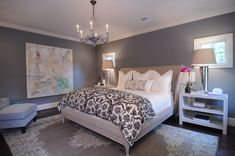 beautiful grey and white bedroom - black  & white damask bed quilt with light grey linen headboard, white nighstands, beautiful classic grey and white rug, medium grey wall paint
