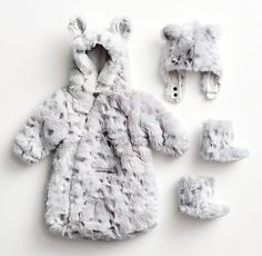 Extra-cozy luxe faux fur bunting, baby animal hood and booties.