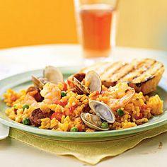Speedy Paella Recipe Main Dishes with dry white wine, saffron threads, chorizo sausage, chopped onion, red bell pepper, paprika, salt, garlic cloves, short-grain rice, fat free less sodium chicken broth, clam juice, plum tomatoes, green peas, littleneck clams, medium shrimp