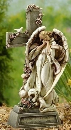 "Guardian Angel with verse ""May you find comfort in the arms of an angel"". Memorial Garden or grave site statue. Loving angel peacefully resting upon a cross adorned with roses. Perfect gift for memori"